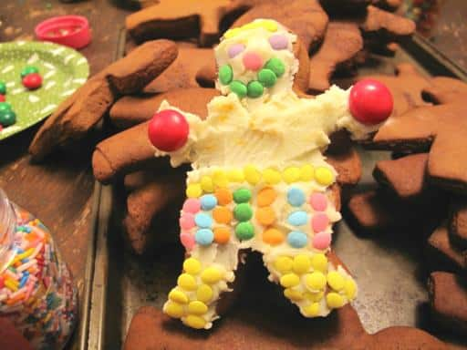 gingerbread cookie with icing and sprinkle decorations