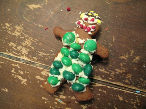 a piece of gingerbread with green, red and yellow sprinkles