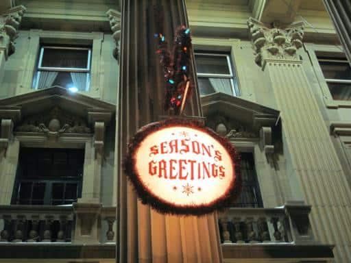 look up shot of Alberta Legislature with season's greetings decor