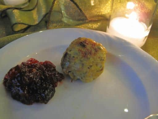 turkey meatball with spicy cranberry chutney in a white plate