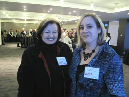 close up photo of two women inside the hall