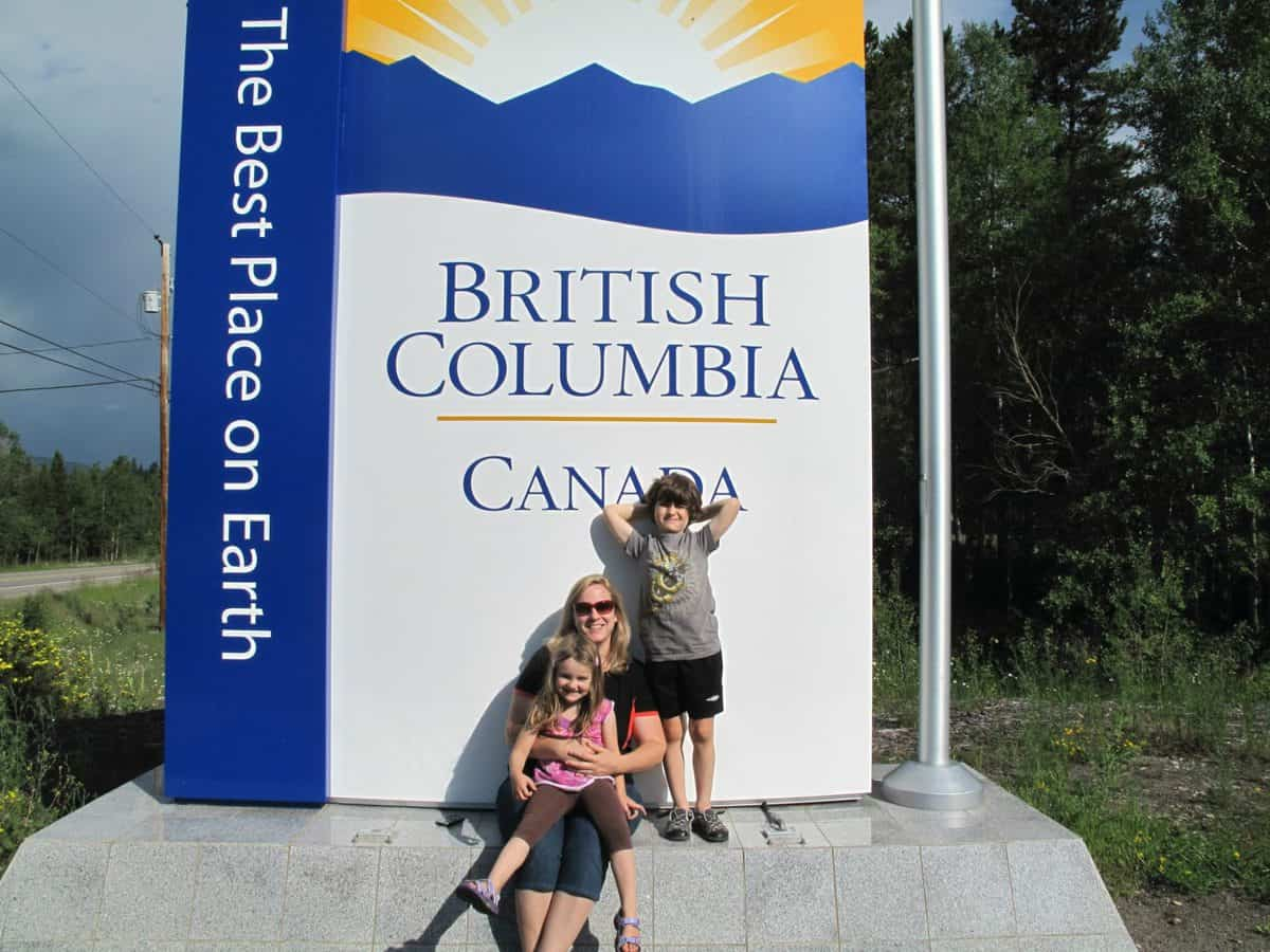 Mom with two kids on a large British Columbia Canada signage