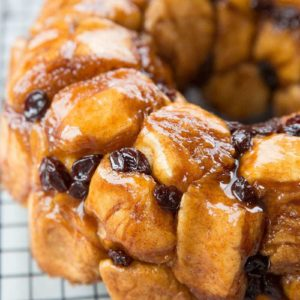 Close up of homemade monkey bread with raisins and brown sugar coating