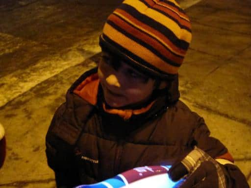 close up of kid wearing a stripe beanie hat