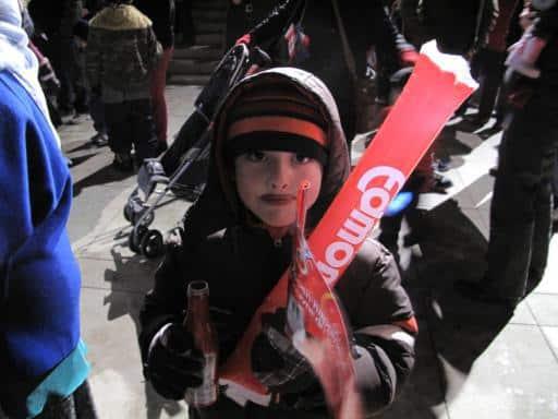 young kid holding Coke merchandise