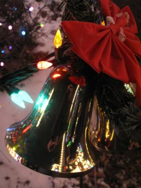 close up of Christmas bell with ribbon