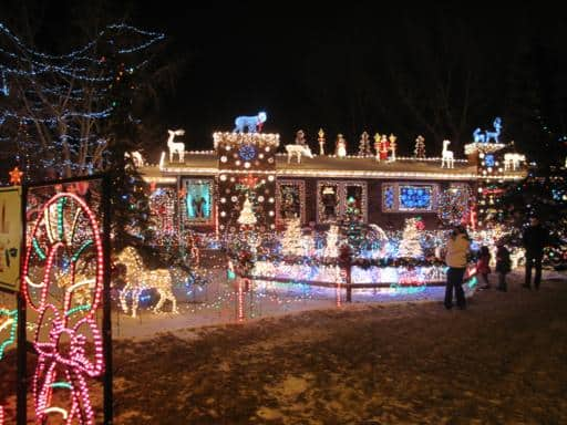 view of one side of the Maisie's Magical Christmas house with lot of light display