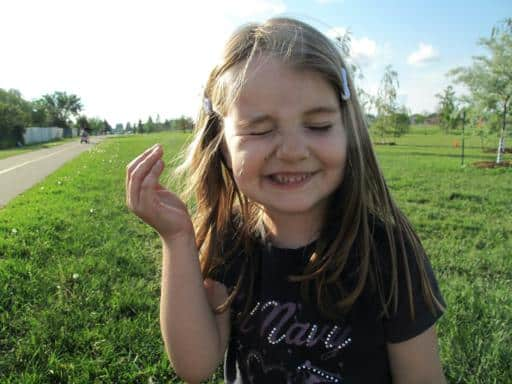 little girl closed her eyes cause of the dandelions she blew