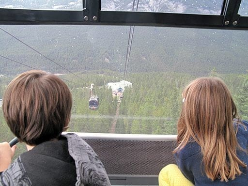 two kids riding the cable car