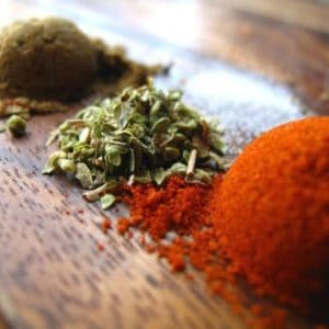 Close up of the ingredients for homemade cajun seasoning.