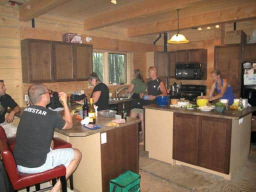 men and women at the kitchen area preparing dishes