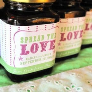 close up of Saskatoon jam in jars with personalized labels