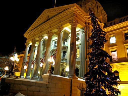 view of lighted Alberta Legislature from outside during Christmas season