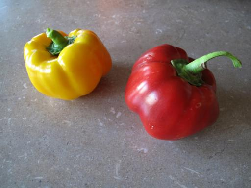 close up of red and yellow peppers