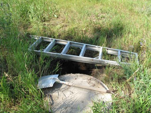 opened septic tank outside the house