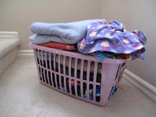 a basket of laundry in the stair