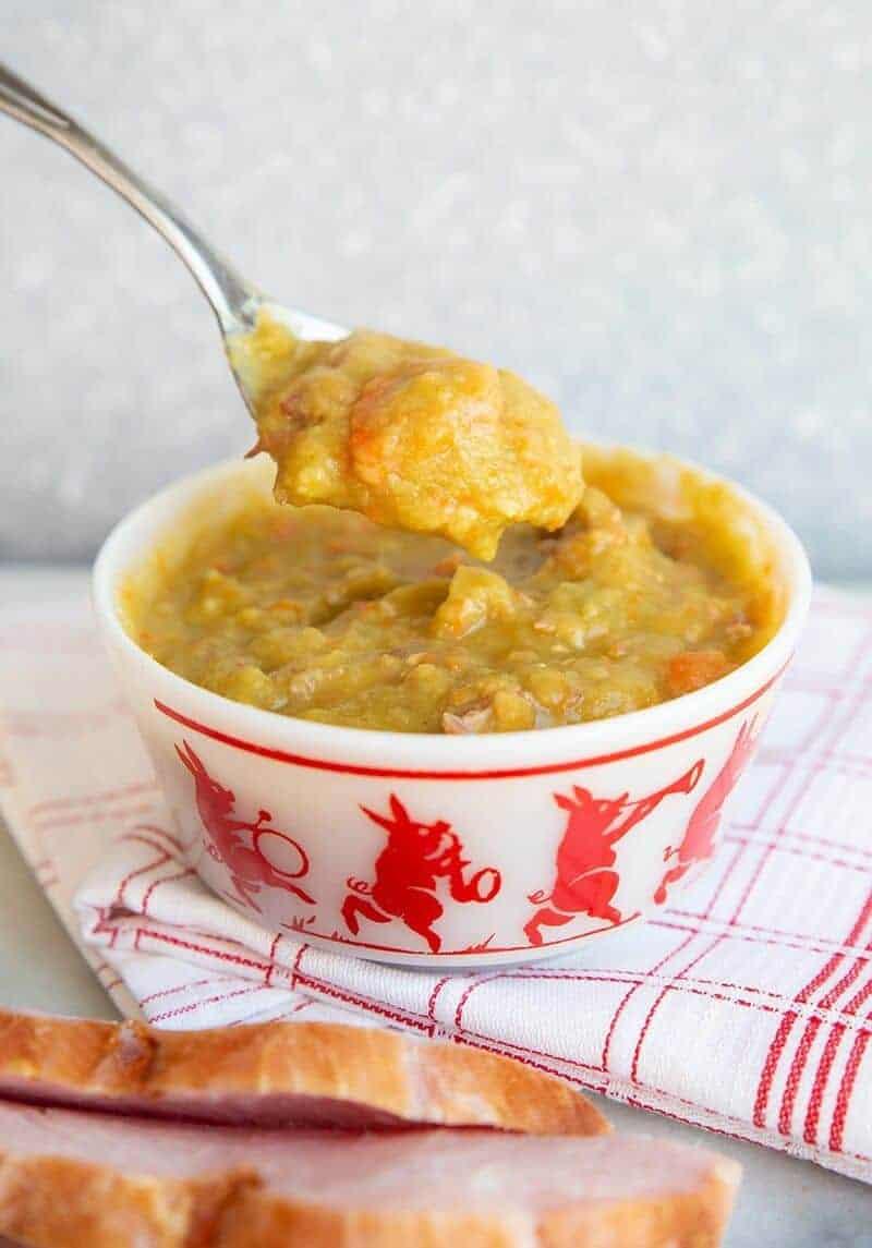 white kitchen cloth underneath a bowl with Split Pea & Ham Soup