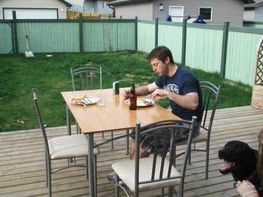 kitchen table on the deck with a man enjoying his meal