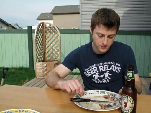 close up of a man enjoying his meal in the deck