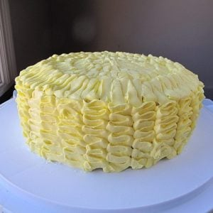 Ruffled Lemon Cake on a white cake holder