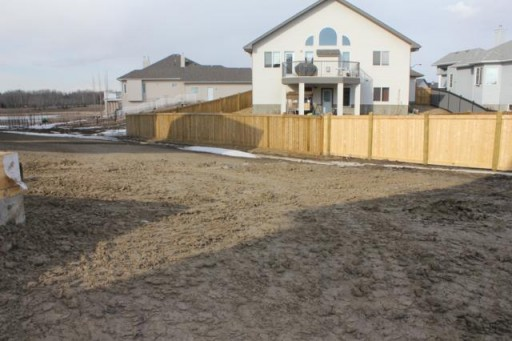 wide yard with fence