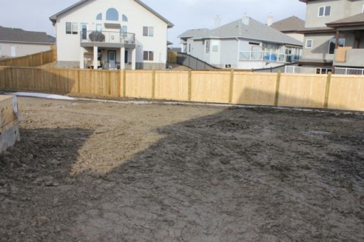 house yard surrounded by fence