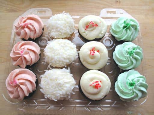 twelve pieces of assorted mini cupcakes with toppings