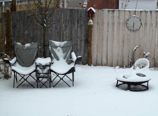 backyard with snow started covering it