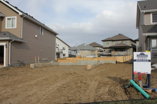 lot with the house foundation started