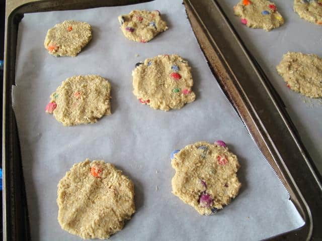 flattened cookie dough in cookie sheets with parchment paper