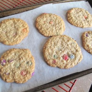 Baked Smartie Oatmeal Cookies in Cookie Sheets with Parchment Paper