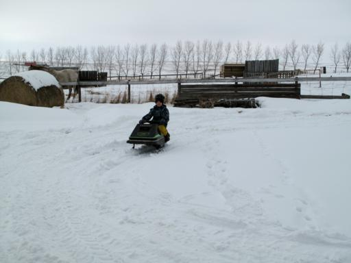 young boy riding his skidoo