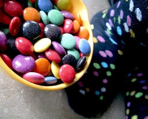 Colorful Smarties in Orange Bowl for Smartie Oatmeal Cookies