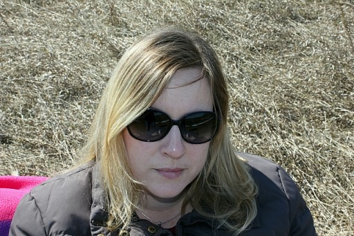 a lady wearing black jacket and sun glasses