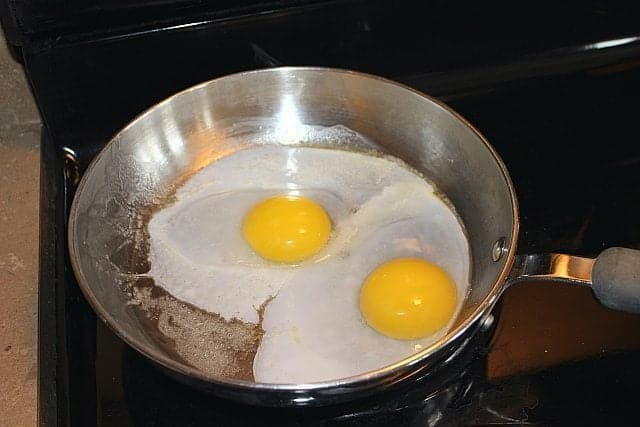 Two Ducks Eggs in a Frying Pan with Butter