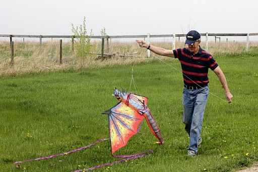man holding the string of huge kite