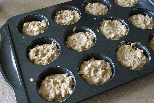 muffin tins filled with Oatmeal Flax Pumpkin dough