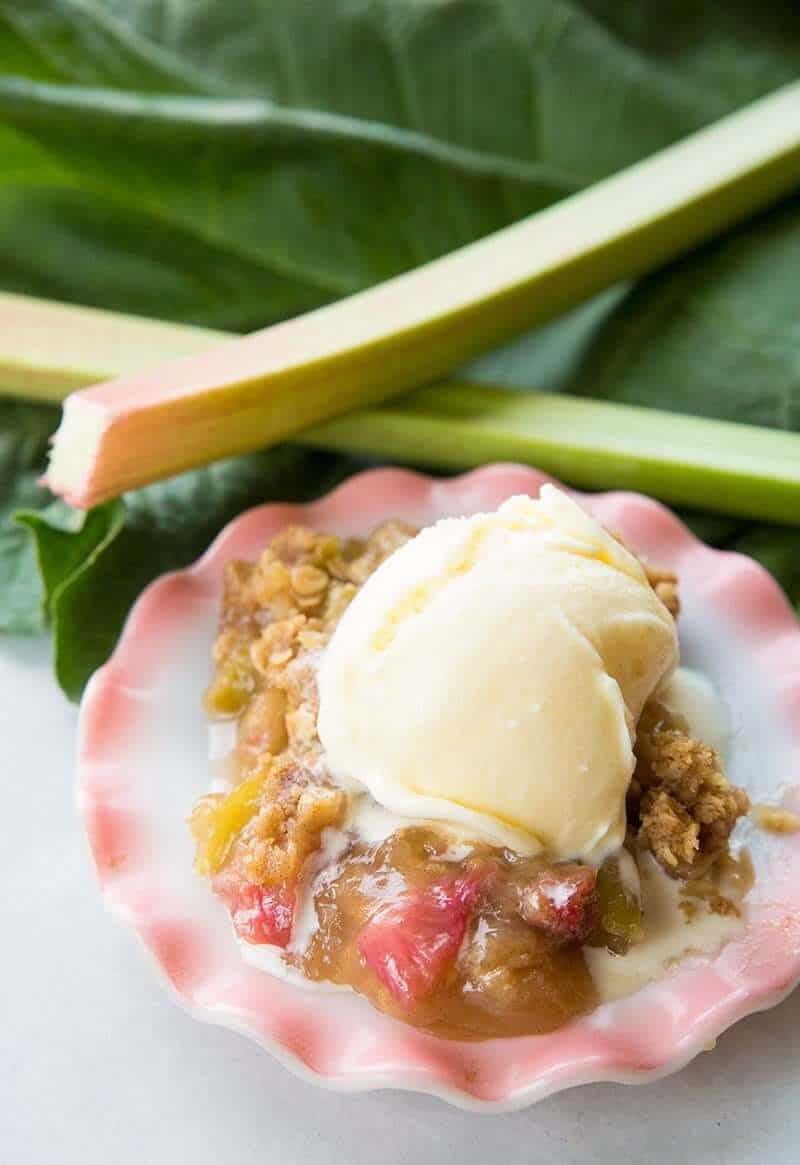 Rhubarb crisp with melting vanilla ice cream on top