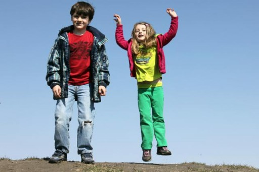 two kids happy outside