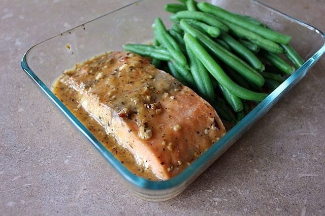 Close up of Salmon & Green Beans in a glass container