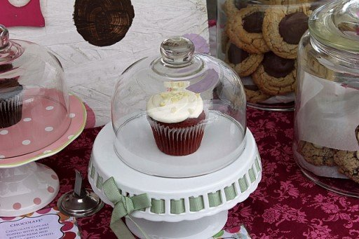 cupcake in a white cupcake stand with cover