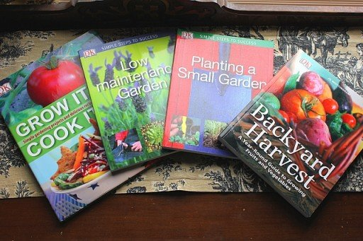 four copies of planting books from DK Publishing
