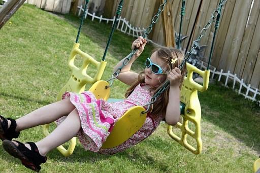little girl enjoying the swing