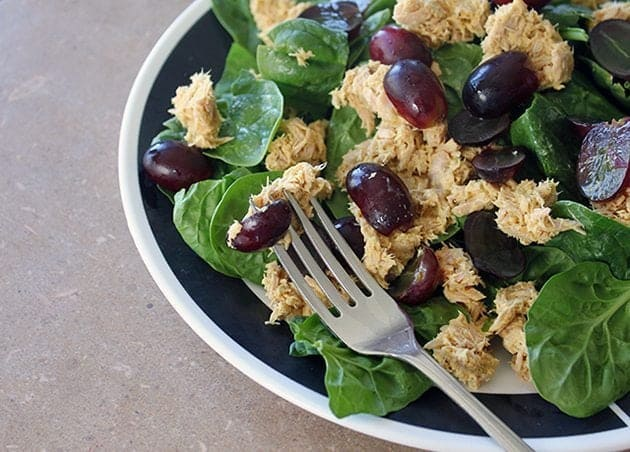 Curry Tuna Salad With Grapes in a bowl with fork