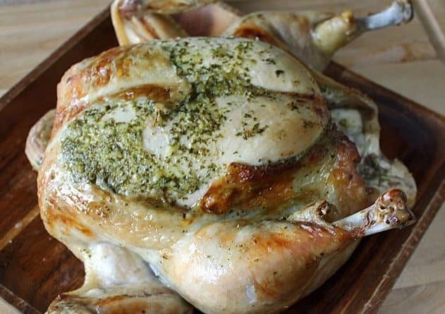 close up Roasted Chicken with Lemon Cilantro in a wood tray