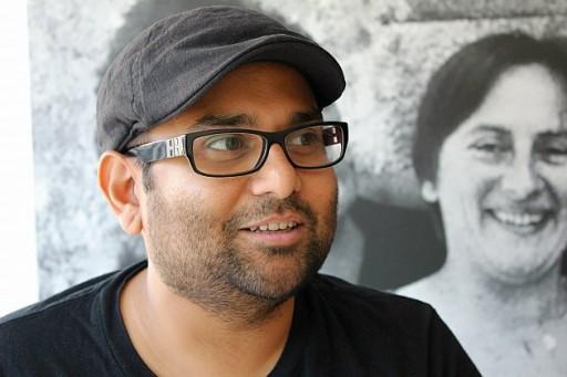 man wearing black shirt, eye glasses and black cap