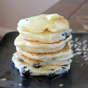 Stack of Yogurt Blueberry Pancakes in a black plate