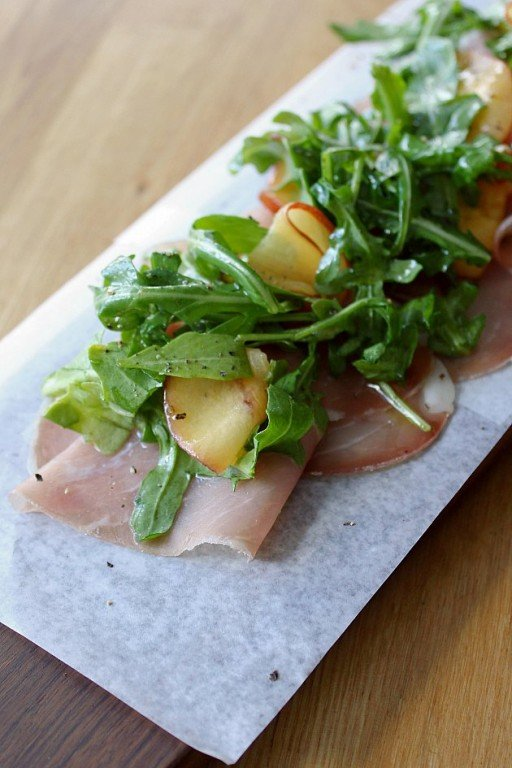 house cured pork loin withshaved nectarines & wild arugula