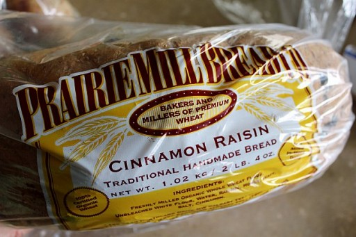 a pack of cinnamon raisin bread by Prairie Mill Bread Company
