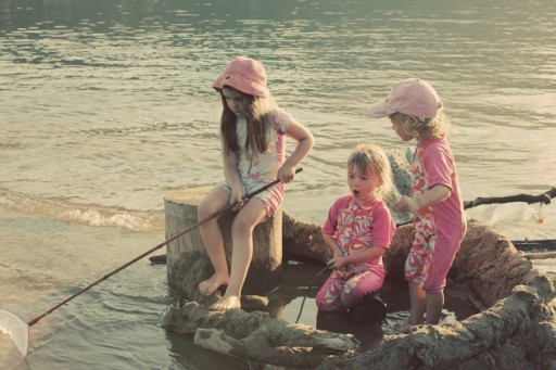 kids in the fort log playing with the lake water